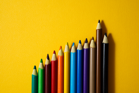Colorful pencil on yellow background. Stock Photo