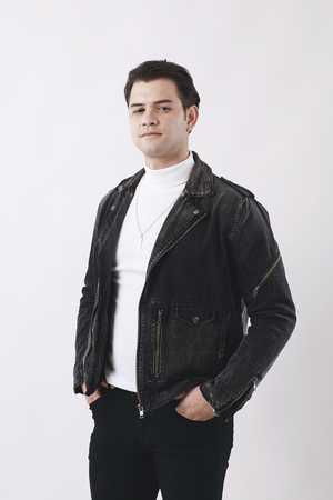 Young man on white background self confidence