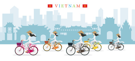 Vietnamese Women with Conical Hat Ride Bicycles, Landmarks Background, Culture, Travel and Tourist Attraction