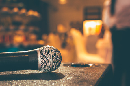 Microphone on the ground and blurred photo of conference hall or seminar room or wedding room background. Banque d'images - 116419765