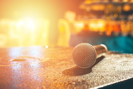 Microphone on the ground and blurred photo of conference hall or seminar room or wedding room background. Banque d'images - 116422884
