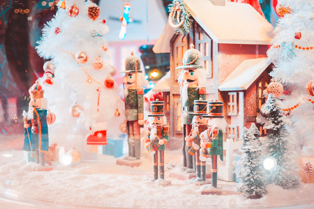 army christmas dall and house with snow in the big glass ball and light. Stock Photo