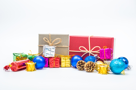 Close up of Cristmas present box with some colorful papper and toys