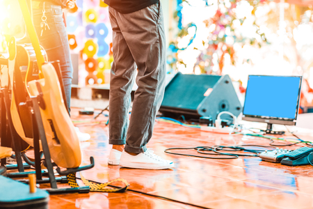 People stand on the music stage in concert.