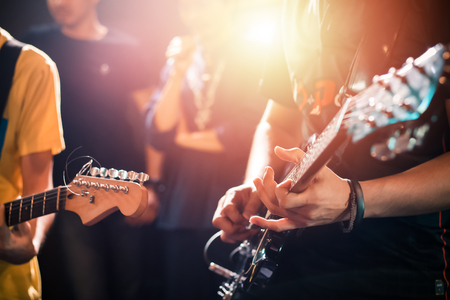 hands playing guitar on the stage, close up Stock Photo