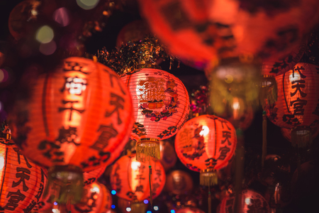 Red Chinese lantern(Translation Hieroglyph text Happy New Year) hanging in a row during day time for Chinese new year celebration. Stock fotó