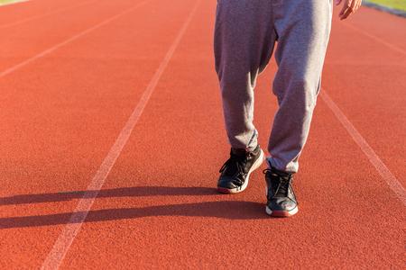 Sport Man jogging or exercise on track race at Stadium.Sport concept. 版權商用圖片