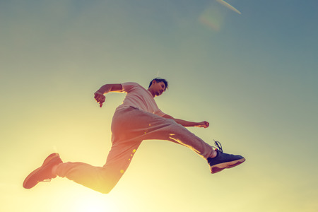 A man running and jump in the air with sunset. 写真素材 - 122672703