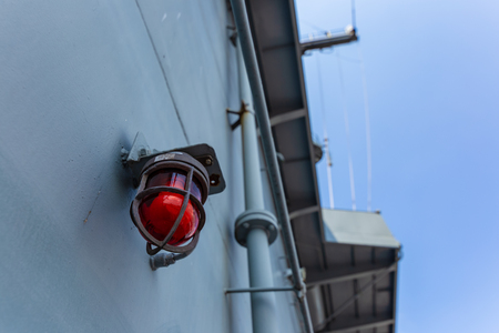 Old Vintage Lamp on Ship Deck Wall Surrounded by Metal Rustic. Bulkhead Light on Navy Ship and blue sky and cloud. 写真素材 - 122673095