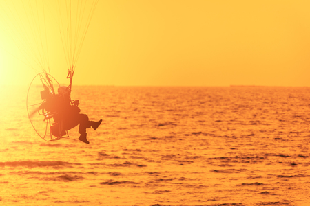 the sport paramotor and sunset clear sky 写真素材 - 122674579