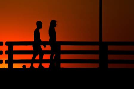 Chonburi , Thailand - March 18, 2018:silhouette people walking on the road with sunset twilight. 写真素材 - 122677665