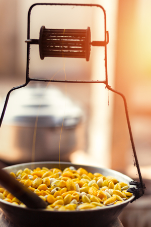 Boiling yellow silkworm cocoons by boiler to make silk thread. 写真素材 - 122677674