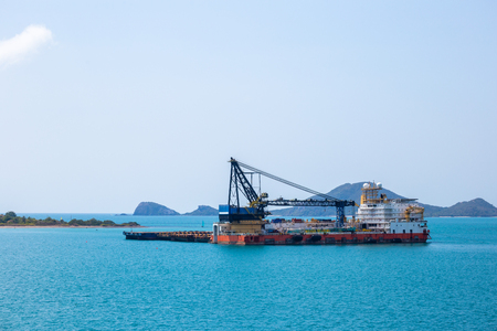 Logistics and transportation Cargo ship and cargo plane in ocean and mountain back. 写真素材 - 122677785