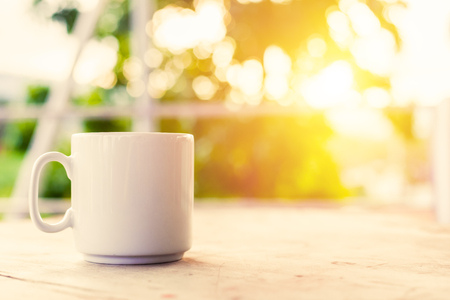 A cup of coffee on the table in the morning.