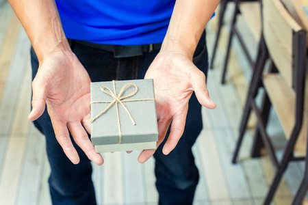 Men hand holding gift box for present valentine day. 写真素材 - 122677800