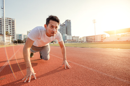 Hands on track race at sport stadium.  A man prepare for start running on track race. 写真素材 - 122677824