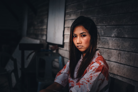 A women sitting at abandonat with Halloween concept. 写真素材 - 123767756