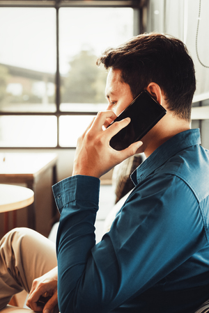 businessman consulting partner by phone. 写真素材 - 123767762