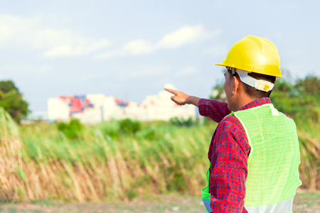 Construction Worker Planning Contractor Checking  at site gas, oil, energy and factory construction. Engineer hand point.