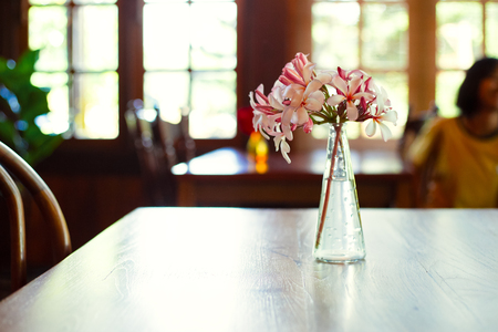 The flower in jar on the table. 写真素材