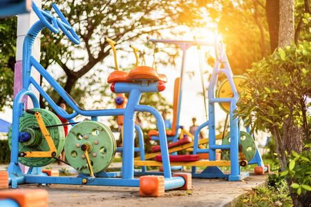 Colorful exercise equipment in public park.