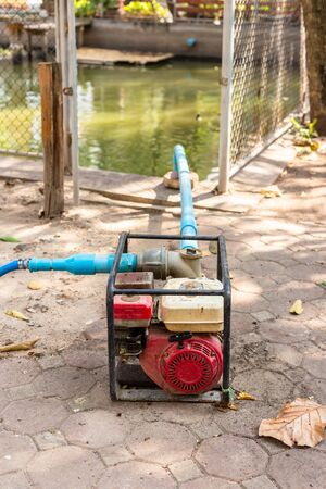 Water pump on the ground in the park.