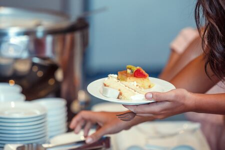 Cream cake and fruit cake in dish. A women and dessert in breakfast. 写真素材