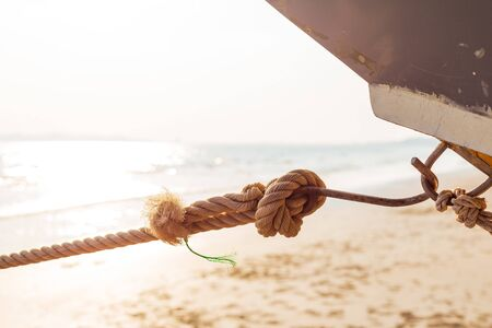 Rope knot of boat on the beach and sun light. 写真素材