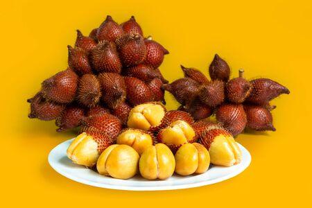 Salak fruit, Salacca zalacca in dish on the table. Asian fruit.