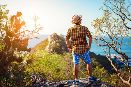 Happy man stand on cliff and enjoying Travel mountain .concept vacations, Holidays.