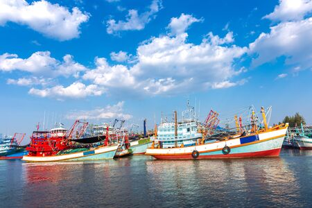 Fishing Boat in the river and blue sky with beautiful cloud.
