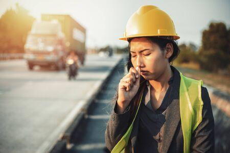 Womens hand holding medical inhalant smelling salt. A women wear safety helmet at site construction.
