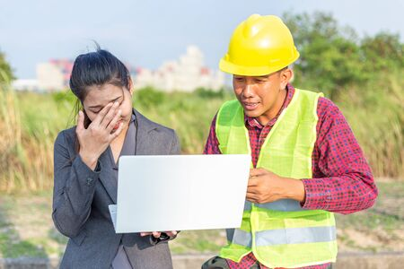 Businesswomen and foreman talking together and happy funny. Engineer and manager teamwork and checking at site construction . 写真素材