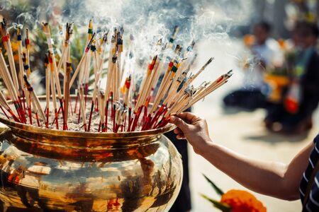 Burning aromatic incense sticks. Incense for praying Buddha or Hindu gods to show respect. 写真素材