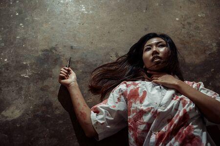 Dead women on the ground in Halloween concept. 写真素材