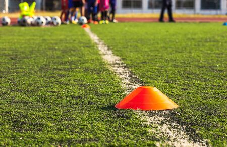 Cone  Marker on football grass at football club. Sport concept.
