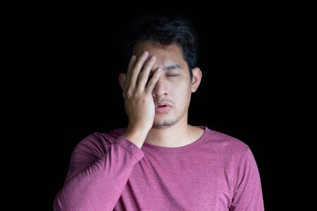 A Man suffering from dizziness and Black background. 写真素材