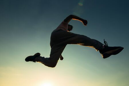 A man running and jump in the air.