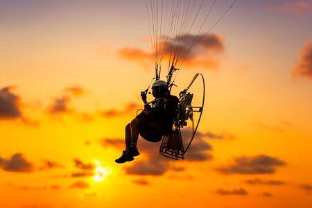 Sport para-motor over the sky at sunset and beautiful cloud.