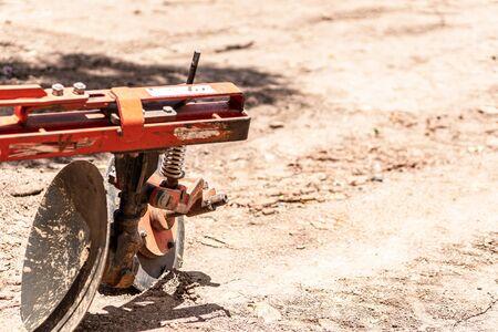 The tractor car plowed soil. Фото со стока
