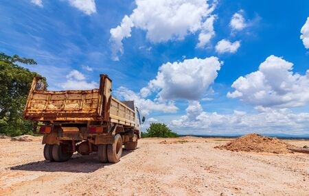 truck at site construction under blue sky and nice cloud midday.