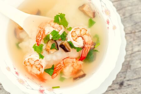 Rice Soup With Shrimp food in breakfast at hotel restaurant. Фото со стока