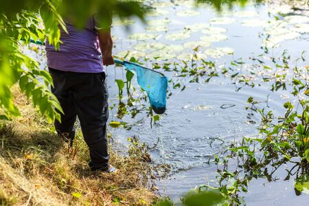 People use Swing net for keep garbage in the water. Banco de Imagens