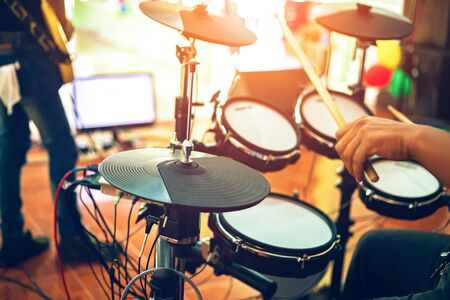 Electric drum on the concert stage with music player. Stock Photo