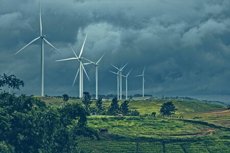 wind turbine on mountain and rain cloud. Stockfoto