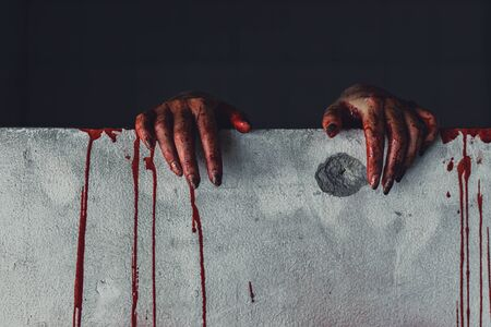 horror scene of woman with scary hand  at abandoned house. hand through the hole wall. Halloween concept Archivio Fotografico