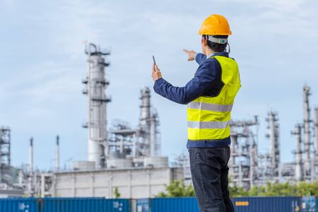Construction Worker Planning Contractor Checking at site gas, oil, energy and factory construction. A man hold tablet for working.
