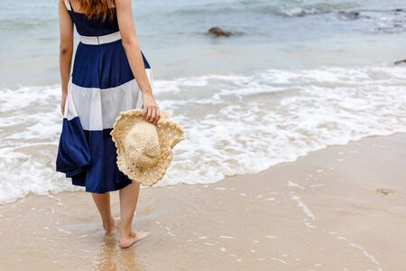 Happy young girl walking on the beach. Summer travel, vocation, holiday concept. 写真素材