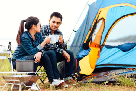 Couples drink coffee together during the morning camping.