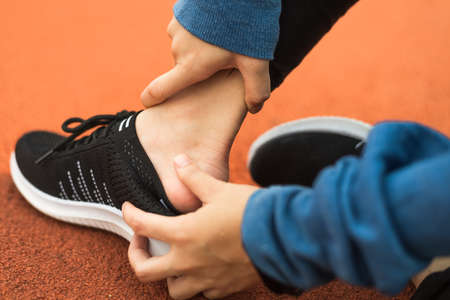Sport shoes hurt feet after running on track race.